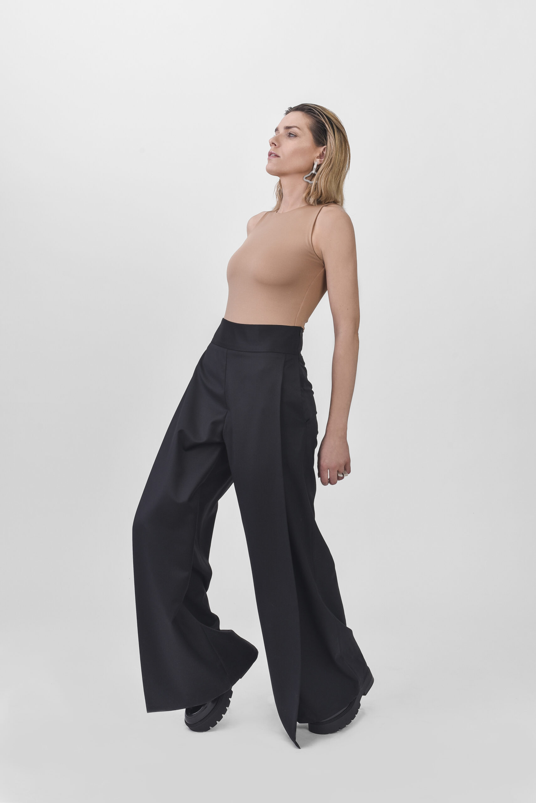 Model with black wide leg trousers