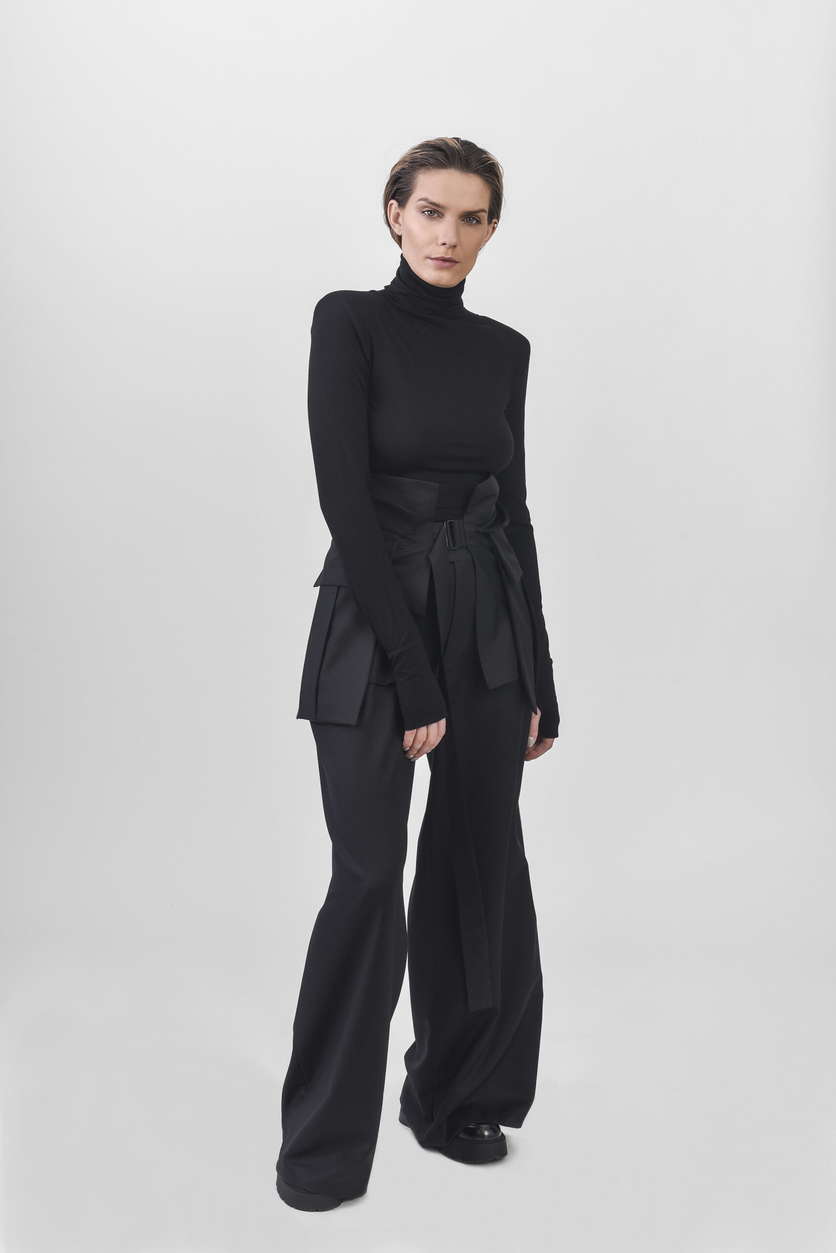 Wide leg trousers and waist belt with black turtleneck